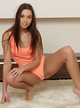 A salmon pink one-piece swimsuit compliments Sabrisse A's slightly tanned body and highlights her firm and svelte legs, meaty rump, and adorable