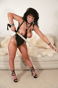 Lustful Matured Chick With Melon Breasts In Bdsm Outfit Threatening Her Cunt With A Samurai
