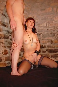 Chained Mom Ginger Pounding A Big Dick In Her Hot Mouth!