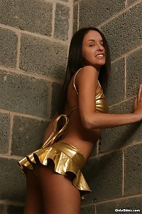 Zaylee Demonstrates Her Gold Latex Underwear On Suntanned Body