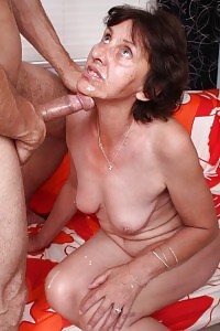 Grannie Stephanie Joins A Young Boy In Her Bed Room And Teases Him By Exhibiting Off Her Jugs